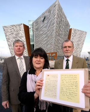 Dr John Edward Simpson's relatives Kate Dornan, her brother Dr John Martin (right) and their cousin Dr Denis Martin (left), with a copy of his letter