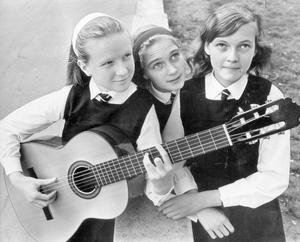 Catherine Thom (13) gave prize day at Methodist College a musical uplift. She played a guitar solo during the junior prize distribution in the Whitla Hall Belfast. Pictured with her are prize winners Mary Jackson (12) and Ruth Eyre (12), 1970.