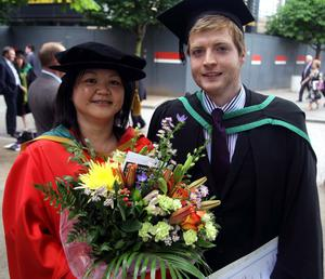 29.06.11. PICTURE BY DAVID FITZGERALDUniversity of Ulster Graduations at the Waterfront Hall, Belfast yesterday. Conall Maguire who studied Property Investment and Development pictured with his lecturer Jasmine Lim