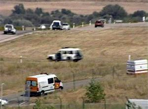 In this photo rendered from video via APTN, emergency vehicles head to the scene of a plane crash in Madrid, on Wednesday, Aug. 20, 2008. Spain's Interior Ministry says at least 45 people are dead after an airliner bound for the Canary Islands swerved off the runway and caught fire during takeoff from the Madrid airport. (AP Photo/APTN)