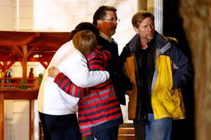 NEWTOWN, CT - DECEMBER 14:  People hug outside of the Newtown United Methodist Church on December 14, 2012 in Newtown, Connecticut. Twenty-seven are dead, including 20 children, after a gunman identified as Adam Lanza in news reports, opened fire in the Sandy Hook School in Newton. Lanza also reportedly died at the scene.  (Photo by Jared Wickerham/Getty Images)
