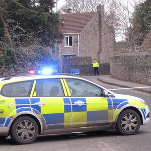 Police close off a road in south Gloucestershire after a man was found dead at a vicarage