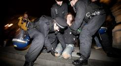 LONDON, ENGLAND - FEBRUARY 28: Police remove members of the Occupy protest movement from the steps of St Paul's Cathedral on February 28, 2012 in London, England. Set up outside the Cathedral in October to protest against capitalism, the activists lost their fight against eviction in the High Court last week. (Photo by Matthew Lloyd/Getty Images)