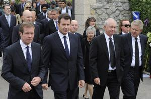 PEDRENA, SPAIN - MAY 11:  (L to R) Chief Executive of The European Tour George O'Grady Nick Faldo of England , Roger Chapman of England and Colin Montgomery of Scotland walk following the urn containing the ashes of Seve Ballesteros to attend the ceremony during the funeral service held for the legendary Spanish golfer on May 11, 2011 in Pedrena, Spain. Top-ranked golf players have joined family members and friends to pay their last respects to the late golf great, who died on May 7, 2011 from complications arising from a brain tumor, in his home town parish church.  (Photo by David Ramos/Getty Images)
