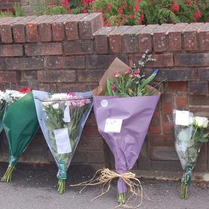 Flowers left outside the home of Chris Hall where he was found dead with his young son, also called Chris, in Poole