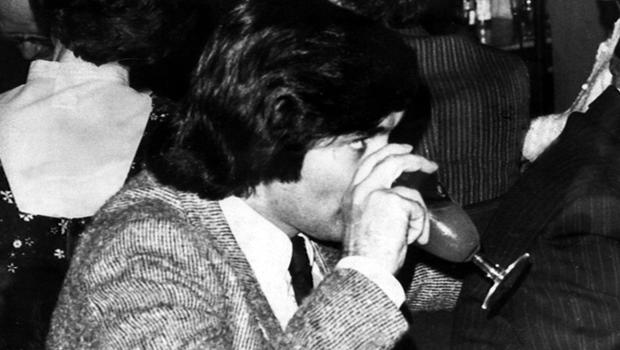 George Best has a drink in a Belfast bar