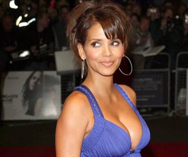 Halle Berry could have difficulty trying to board a plane with this much cleavage on display if the experience of a New York passenger is anything to go by