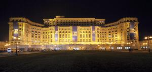 "Night view shows the lightened Parliament Palace, the second largest building in the world after the Pentagon, in Bucharest on April 2, 2008  The vast, lavish ""Palace of the Parliament,"" cwas ommissioned by Romania's communist leader Nicolae Ceausescu."