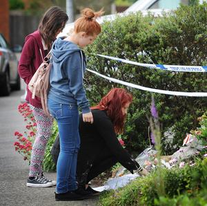 Friends of Megan-Leigh Peat lay floral tributes at the scene of her death