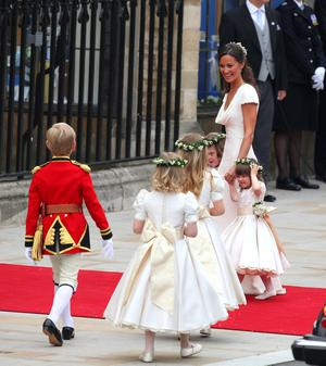 Page boys and bridesmaids arrive at Westminster Abbey, London, escorted by Pippa Middleton before her sister, Kate's, marriage to Prince William