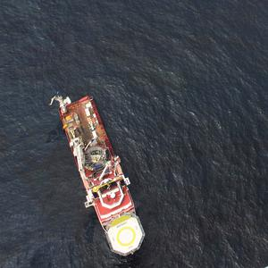 Support ships in oily water near the Gulf of Mexico oil spill