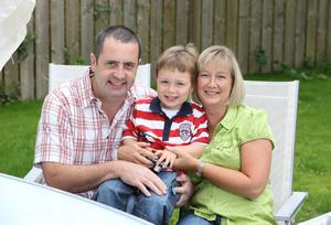Gill Hanna with her husband Stephen and son Sam