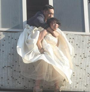 How the drama unfolded as ditched bride-to-be Li is rescued from the seventh floor window of an apartment block in China