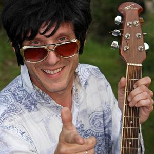 Simon Goldsmith poses as Elvis Presley ahead of a record singing attempt