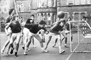 Methodist College Belfast-Fifth formers take part in a practice game of soccer in the school grounds, 1975.