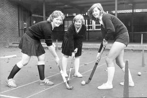 Getting in practice are three members of the Methody second XI hockey team- Christine Browne, Rosie Jones and Susan Elliot, 1975.