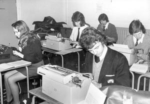Methodist College Belfast- Mastering the art of typing are pupils on one of the business classes, 1975.