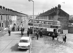 Riots : Belfast. August 1969.  One of the fifty buses driven from the Belfast Corporation depot at Ardoyne for use as street barricades, is removed by workmen after the tyres were inflated and engine repairs made.  (18/8/69)
