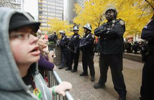 NEW YORK, NY - NOVEMBER 15: Occupy Wall Street activists protest outside Zuccotti Park after police removed the protesters early in the morning from Zuccotti Park on November 15, 2011 in New York City. Hundreds of protesters, who rallied against inequality in America, have slept in tents and under tarps since September 17 in Zuccotti Park, which has since become the epicenter of the global Occupy movement. The raid in New York City follows recent similar moves in Oakland, California, and Portland, Oregon.   (Photo by Mario Tama/Getty Images)