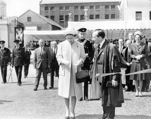 The Queen, Elizabeth 11. 1966 visit.The Queen cuts the tape to mark the official opening of the new Queens Bridge. With her is Alderman J. F. Cairns, chairman of the Belfast Corporation improvement committee.  4/7/1966