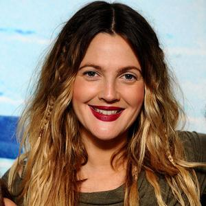 Drew Barrymore says she still feels like she is playing at being a responsible adult