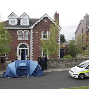 Police and private security guards at the former Killiney home of Brendan and Asta Kelly after their evection