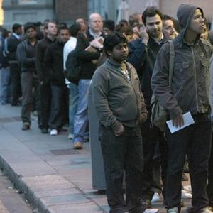 Hundreds queue for jobs at a supermarket in Dublin: new figures show unemployment in Ireland is continuing to increase