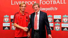 Welcome to Anfield: Liverpool boss Roy Hodgson greets new signing Christian Poulsen after the midfielder completed his switch from Italian giants Juventus