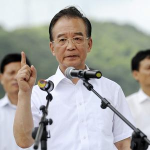 Chinese Premier Wen Jiabao speaks to reporters at the site of the train crash, in Wenzhou in east China's Zhejiang Province