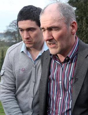 A distraught Mickey Harte with son Michael.
