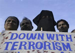 "Indian Muslims,protest against terrorist attacks in Mumbai, as a placard reads "" Kill terror not terrorist "" in Ahmadabad, India, Saturday, Nov. 29, 2008. Indian commandos killed the last remaining gunmen holed up at a luxury Mumbai hotel Saturday, ending a 60-hour rampage through India's financial capital by suspected Islamic militants that killed people and rocked the nation. (AP Photo/Ajit Solanki)"