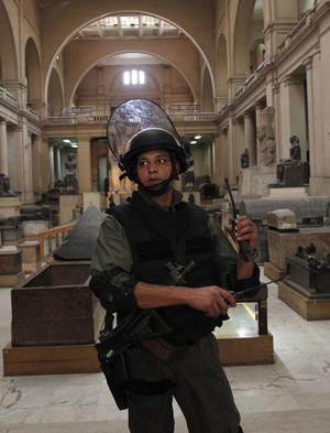 Egyptian special forces secure the main floor inside the Egyptian Museum in Cairo, Egypt, Monday, Jan. 31, 2011. Would-be looters broke into Cairo's famed Egyptian Museum on Saturday Jan. 29, 2011, ripping the heads off two mummies and damaging some artifacts before being caught and detained by army soldiers, Egypt's antiquities chief Zahi Hawass said Saturday, while reporting that the vandals did not manage to steal any of the museum's antiquities, and that the prized collection is secure from thieves and under military guard.(AP Photo/Tara Todras-Whitehill)