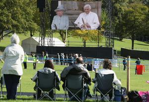 Pilgrims gather ahead of the arrival of Pope Benedict XVI for the Papal Mass at Bellahouston Park, Glasgow