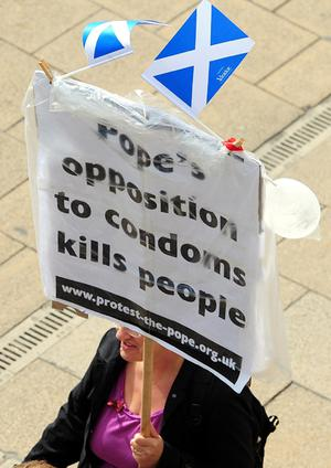 A demonstrator in Edinburgh as Pope Benedict XVI begins his first papal state visit to the UK
