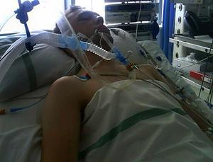 Andrew McDowell lies in a coma in the Royal Victoria Hospital