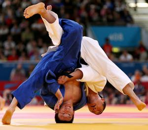 Kazakhstan's Sergey Lim is thrown by Japan's Masashi Ebinuma (right) in the Men's 66kg Judo Round of 16 at the ExCeL Centre on the second day of the London 2012 Olympics.