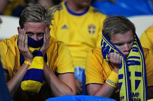 Sweden fans are left dejected after the final whistle during the UEFA Euro 2012 Group D match at the Olympic Stadium, Kyiv, Ukraine. PRESS ASSOCIATION Photo. Picture date: Friday June 15, 2012. See PA Story SOCCER England. Photo credit should read: PA Wire. RESTRICTIONS: Use subject to restrictions. Editorial use only. Book sales permitted providing not solely devoted to any one team / player / match. No commercial use. Call +44 (0)1158 447447 for further information.