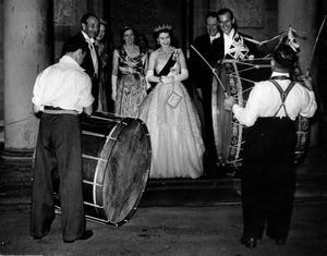 The Queen, Elizabeth 11. 1953. Coronation Year visit.The Queen and Duke, with The Governor, Lady Wakehurst, The Prime Minister and lady Brookeborough, chat with two traditional Lambeg drummers on the steps of Government House, Hillsborough.  1/7/1953
