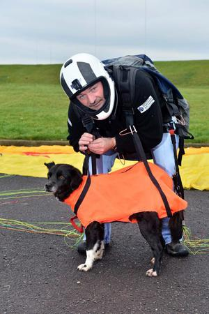 Tony Conway with his cross collie Harry which he takes flying