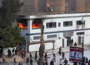 A fire station seen burning during clashes between protestors and anti-riot policemen in Suez, Egypt, Thursday, Jan. 27, 2011. Egyptian activists protested for a third day as social networking sites called for a mass rally in the capital Cairo after Friday prayers, keeping up the momentum of the country's largest anti-government protests in years. (AP Photo)