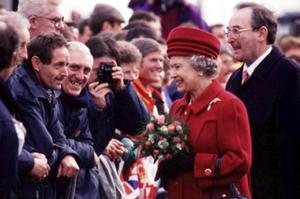 The Queen, Elizabeth 11. 1995 visit.The Queen is welcomed by well-wishers on her walk across the new Lagan Bridge.  March 1995