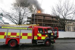 Fire crew tackle a blaze at the back of the Union Theological College on Botanic Avenue