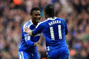 LONDON, ENGLAND - APRIL 15:  Didier Drogba of Chelsea (11) celebrates with John Obi Mikel as he scores their first goal during the FA Cup with Budweiser Semi Final match between Tottenham Hotspur and Chelsea at Wembley Stadium on April 15, 2012 in London, England.  (Photo by Michael Steele/Getty Images)