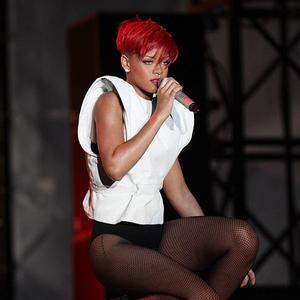 US-based singer Rihanna held off Take That as she clung to the top spot with her upbeat single Only Girl (In the World)