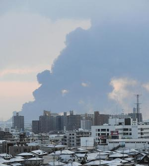 Smoke rises from Tagajo city as it is observed from Sendai, Miyagi Prefecture, Saturday morning, March 12, 2011 after Japan's biggest recorded earthquake slammed into its eastern coast