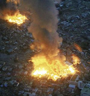 Buildings burn in Yamada town, Iwate prefecture (state) after Japan's biggest recorded earthquake hit  Friday March 11, 2011