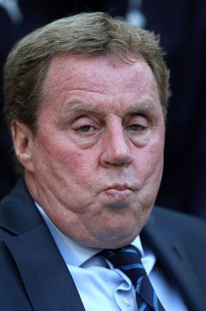 Tottenham Hotspur manager Harry Redknapp pictured during yesterday's FA Cup semi-final against Chelsea at Wembley Stadium  looks frustrated during the FA Cup, sem-final at Wembley Stadium, London