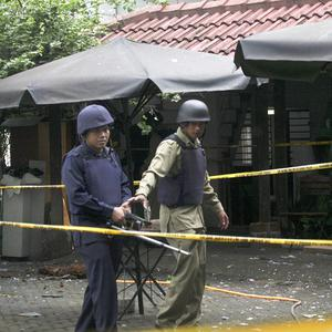 Members of Indonesian Police bomb squad inspect damage outside the office of Islamic Liberal Network (AP)