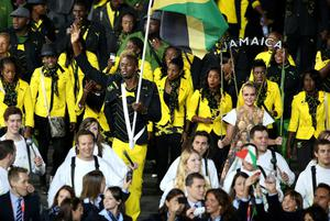 Jamaica's Usain Bolt carries his countries flag at the Opening Ceremony at the Olympic Stadium, London. PRESS ASSOCIATION Photo. Picture date: Friday July 27, 2012. See PA story OLYMPICS Ceremony. Photo credit should read: Mike Egerton/PA Wire. EDITORIAL USE ONLY