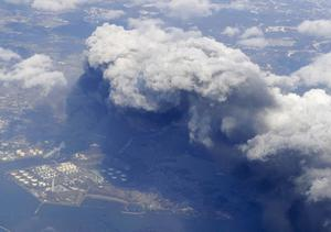 Smoke rises from burning facilities in an industrial zone in Tagajo, Miyagi Prefecture, Saturday morning, March 12, 2011 after Japan's biggest recorded earthquake slammed into its eastern coast Frida